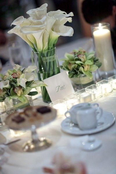 White Calla Lilly  reception wedding flowers,  wedding decor, wedding flower centerpiece, wedding flower arrangement, add pic source on comment and we will update it. www.myfloweraffai... can create this beautiful wedding flower look.