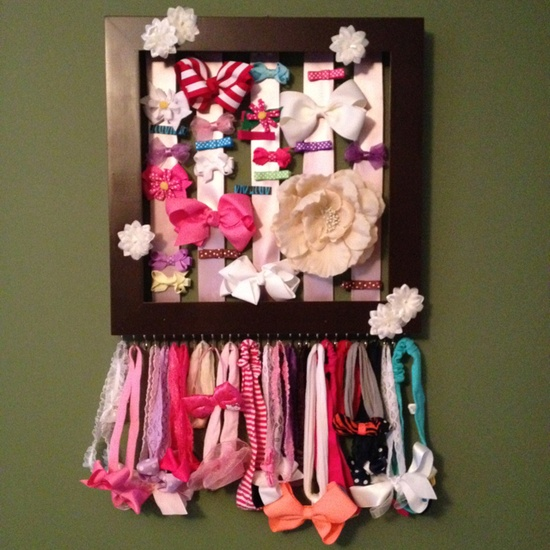 Perfect hair accessory holder for a little girl's room. All you need is a picture frame, ribbon and some hooks for the headbands