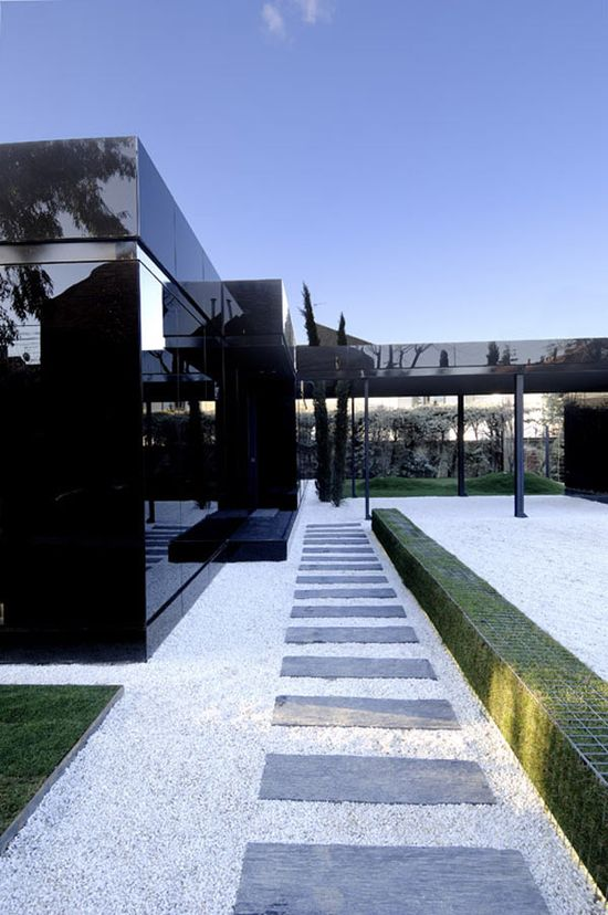 Black Glass Home View 2 - great idea for the hedges