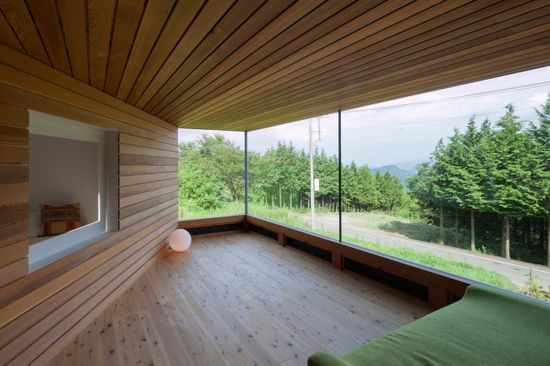 Skyward House by Kazuhiko Kishimoto / acaa \\\ This outer room almost feels like it's outdoors with the warm wood panels and wide expanses of glass.