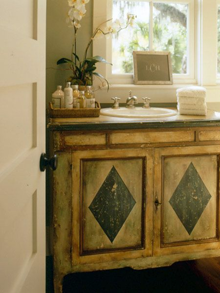 A distinctive vanity, hand-painted in Italy, provides a unique place to prepare for the day. (Photo: Photo: John O'Hagan;)