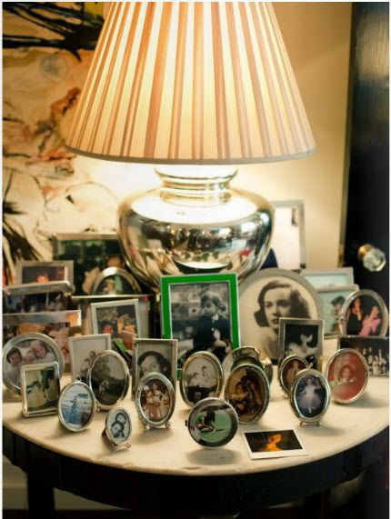 Love a mixed display of family pictures via Marcus Design: {from kate spade's home}