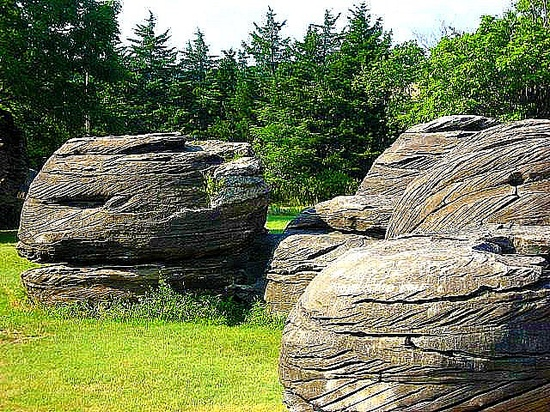 "A geologic wonder located near Minneapolis, Kansas, Rock City has been  designated a National Natural Landmark. The large spherical boulders  in Rock City are giant calcite-cemented concretions, typically called  ""cannonball concretions"" because of their shape"