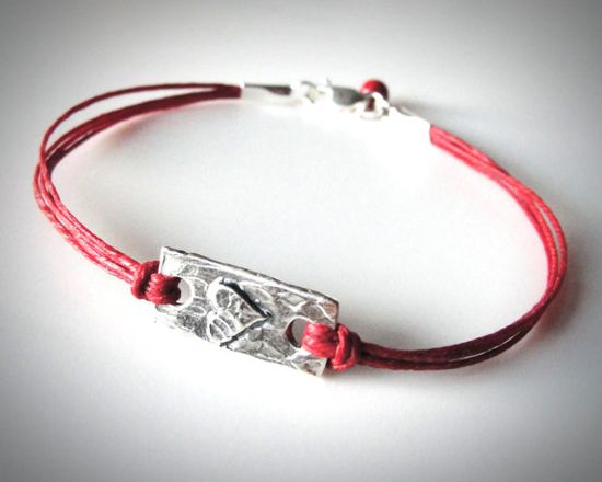 Perfect for valentine's day! Sterling Heart Bracelet on red linen from JewelryByMaeBee on Etsy.