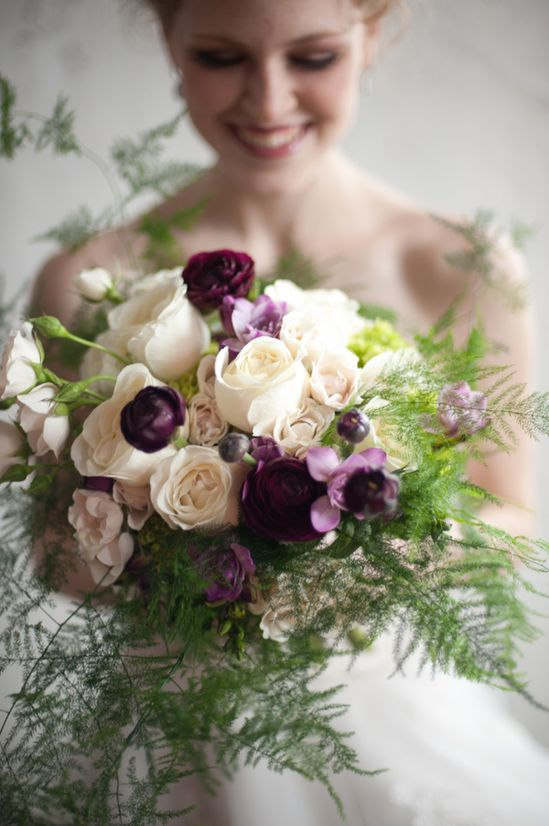 Deep purple Ranunculus and ivory rose bouquet.