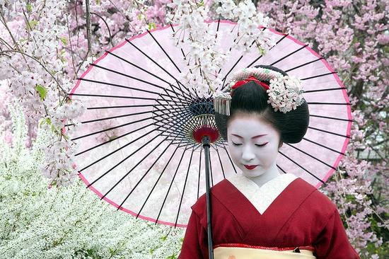Geisha with umbrella.