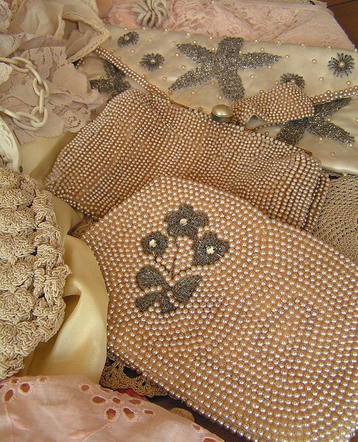Lovely collection of vintage beaded purses in pale pinks and creams.