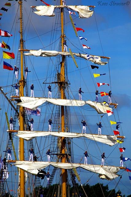 Sailors waving goodbye on the KRI Dewaruci Holland