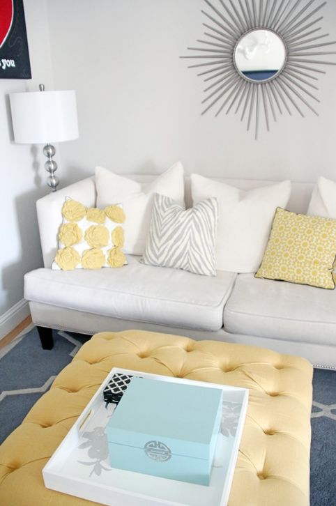 yellow and grey living room – yellow ottoman, patterned pillows