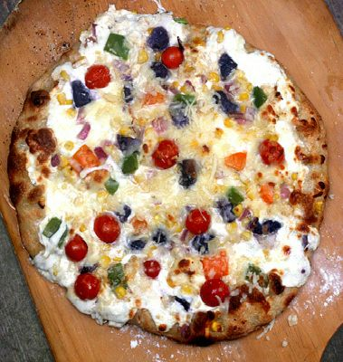 Fresh Mozzarella, Parmesan, Roasted Garlic Cream Cheese Pizza with Summer Vegetables (Corn, Potatoes (I used blue potatoes), Grape Tomatoes, Bell Peppers, plus a recipe for Sourdough Pizza Crust, but you can use any pizza crust you like.