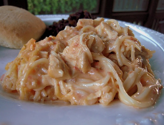 Rotel Chicken Spaghetti!  3-4 large boneless chicken breasts (or rotisserie chicken)   1 can (10 3/4 ounce) Cream of Chicken Soup   1 can (10 ounce) Rotel Diced Tomatoes with Green Chilies   1 clove garlic, minced or 1/2 tsp. garlic powder    1/2 tsp. onion powder   1 tablespoon Margarine or butter   1 – 8 ounce Velveeta cheese, cubed   8 ounces spaghetti, cooked and drained