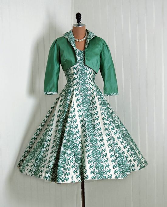 Green and white printed cotton sundress  and green cotton jacket with printed trim, by Saks Fifth Avenue, American, 1950s.