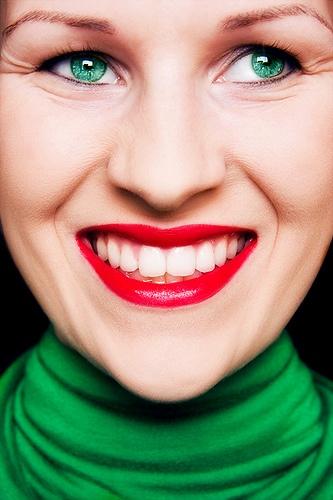 Red lips, green eyes, via Flickr.
