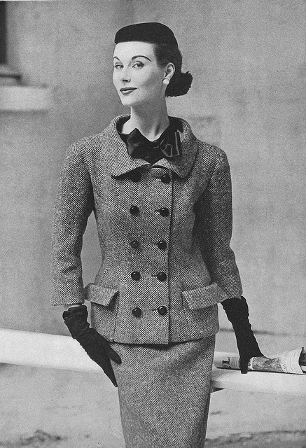 Love the bow resting above a double breasted jacket. #suit #vintage #fashion #1950s