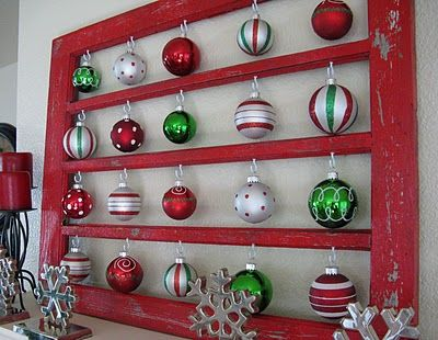 Check out this pretty ornament holder made from a window frame (A Diamond in the Stuff)...would be so pretty with all of my grandmothers old ornaments