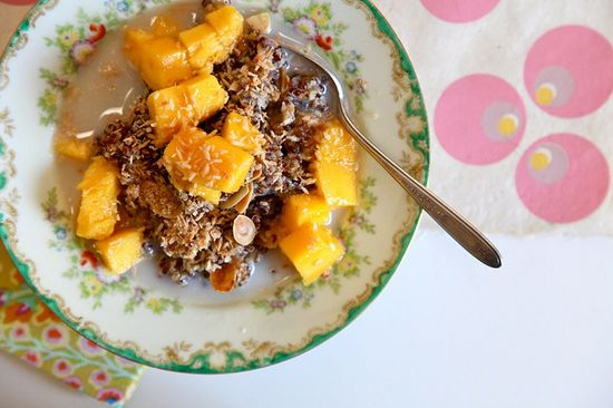 Breakfast quinoa with toasted coconut, almonds, and fresh mango