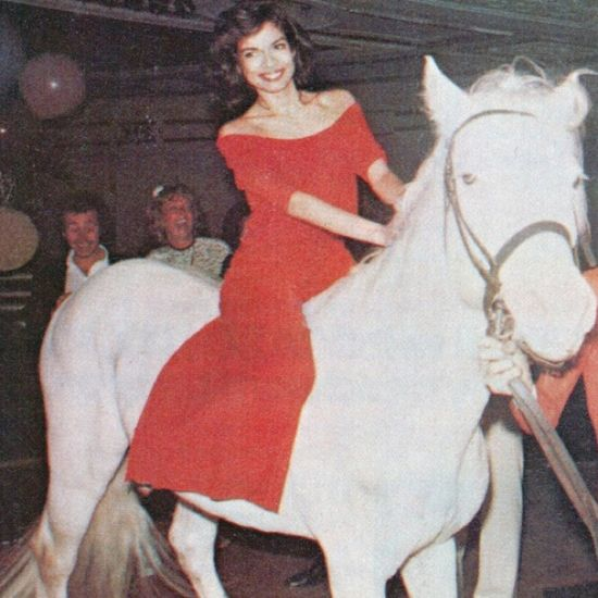 bianca jagger riding in on a white horse—the epitome of studio 54 glamour. (september 2013)