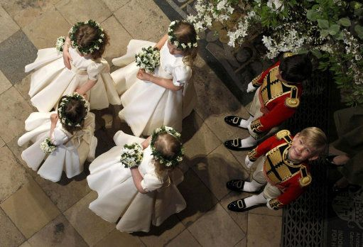 Page boy Tom Petiffer (right) glances up as he waits with bridesmaids and page boys inside Westminster Abbey before the marriage service of Prince William and Catherine Middleton, 29 April 2011.