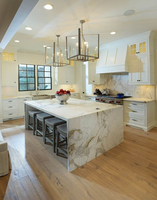 Kitchen, marble waterfall, island.  Interiors: Lori Paranjape, Redo Home & Design