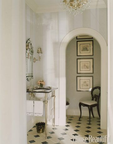 Gorgeous Powder room featured in House Beautiful.....art in the bath--lovely with the chair