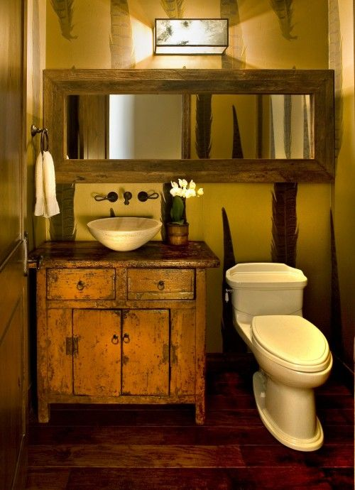 Use of long mirror and rustic cabinet… Big mirror – rustic vanity. Bold idea f