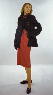 Model is wearing a navy wool Melton cloth short coat and a red wool jersey trouser skirt, 1946. #vintage #fashion #1940s