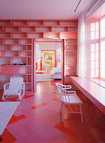 pink color floor to ceiling shelving
