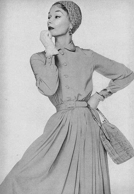 Model is wearing a buttercup yellow silk dress by Norman Norell. #vintage #fashion #1950s