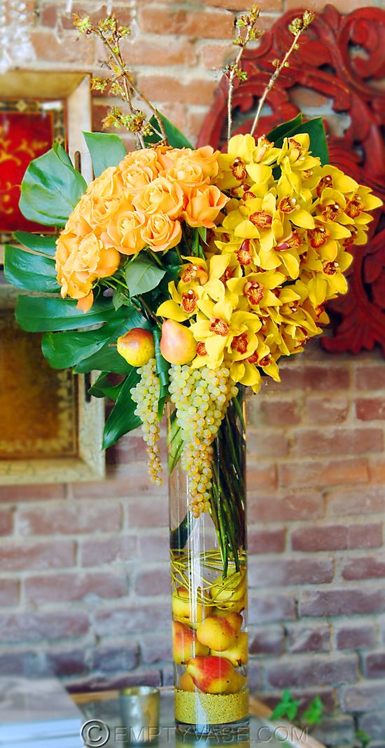 Beautiful exotic arrangement with florals and fruit