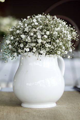 Love the plain and simple flower arrangement , baby breath and milk jar