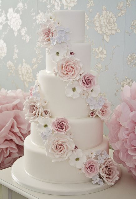 Falling flowers wedding cake by Cotton and Crumbs, via Flickr