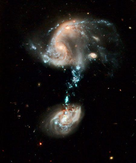 Hubble image of Arp 194 cosmic fountain of stars, gas and dust that stretches over 100,000 light-years.