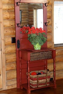 Old Door & Old Side Table...re-purposed into an awesome prim hall tree/entry table!!  Love the basket where there used to be a drawer & the red paint color!
