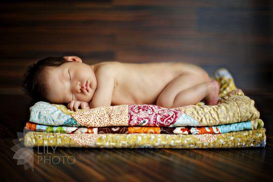 newborn on quilt