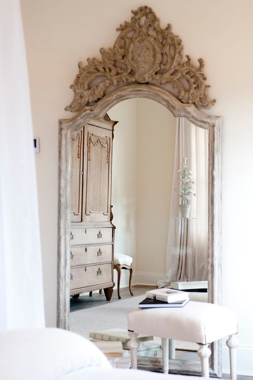 Chic decor carved mirror or maybe added carved piece above a mirror.