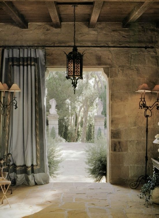 Rustic entry way, stone walls, opening out to garden breadandolives: