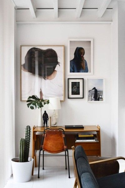 white frames vs. dark frames. #artwork #frames #office #desk #modern #eclectic
