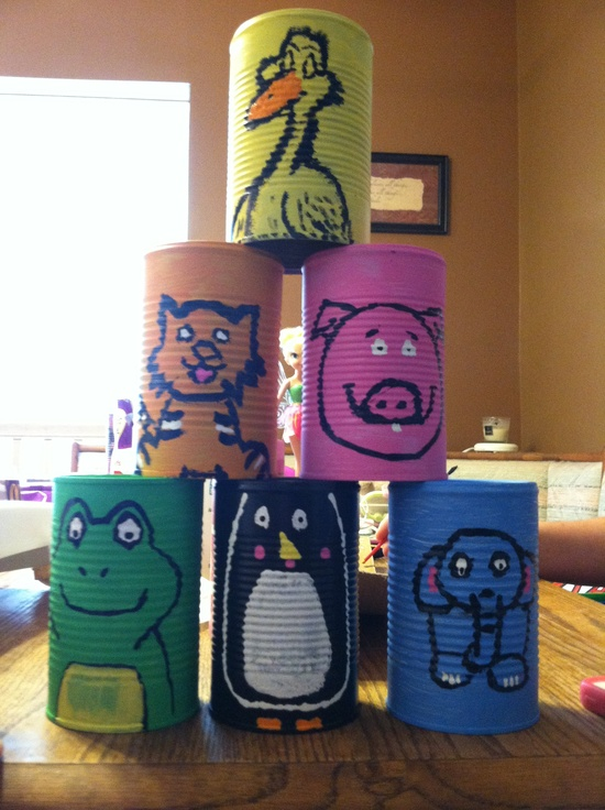 Carnival game! Zoo animal party theme-- throw the ball and knock over the cans!