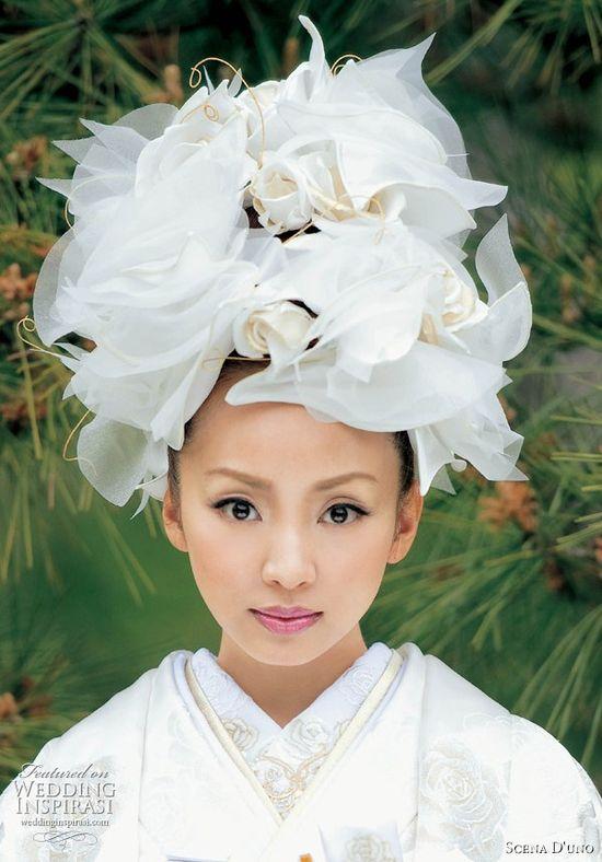 Traditional Japanese wedding kimono: white uchikake kimono from Scena D'uno 2010 collection, designed and modeled by Uno Kanda