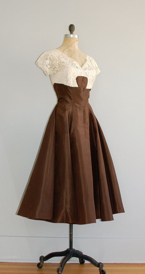 1950s Oleg Cassini brown party dress with cream lace bodice.