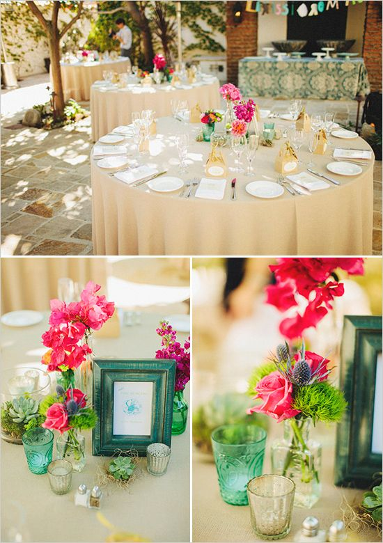 Simple flower arrangements on the tables and I love that colored picture frame for the table number