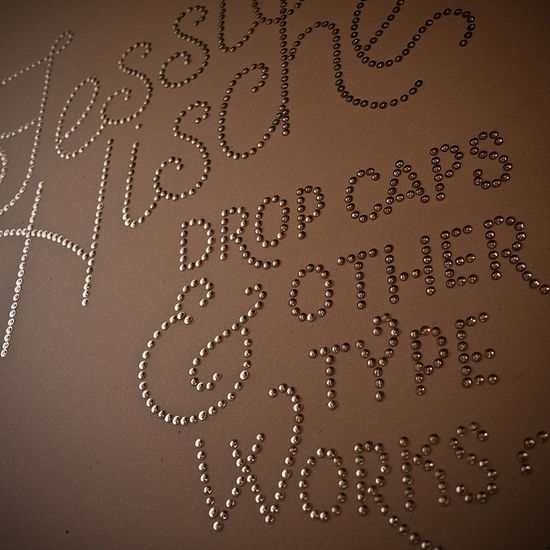 Words made with thumb tacks on the wall.  I AM doing this!!