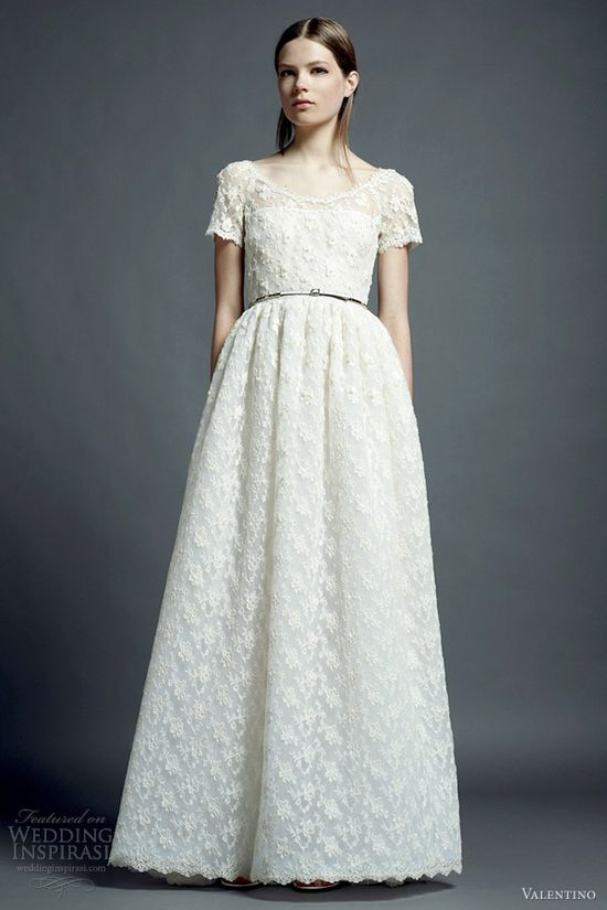 Simple lace short sleeved wedding dress.