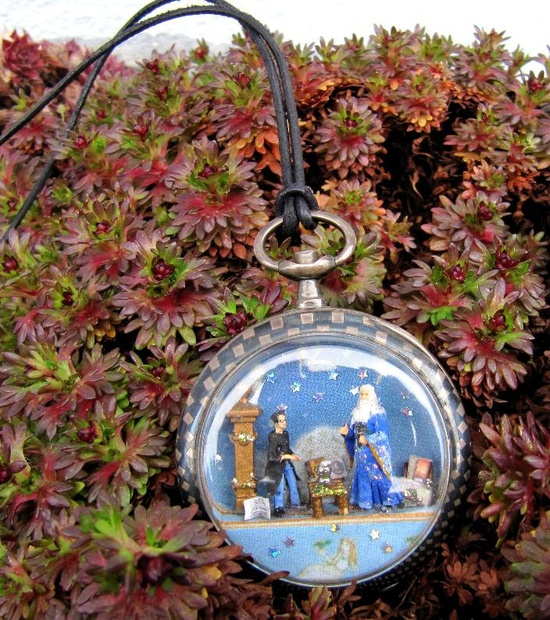 Unique necklace- Miniature 144th scale-  Harry Potter and Dumbledore in an antique silver watch case. $120.00, via Etsy.