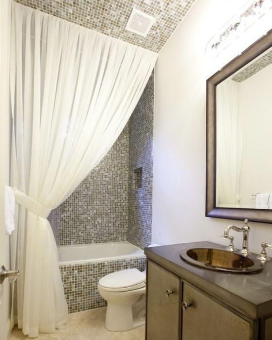 Floor to ceiling side swag, substantial vanity (= storage), teeny tiles.