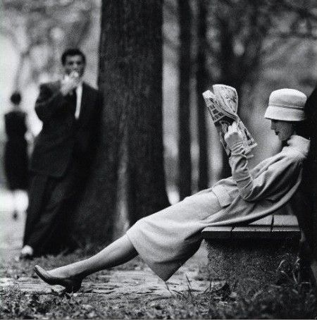 Woman on a park bench in Central Park, New York, 1957. Shot by Yale Joel.