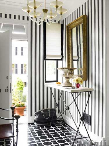Black and white marble floor tiles with black and white striped wallpaper