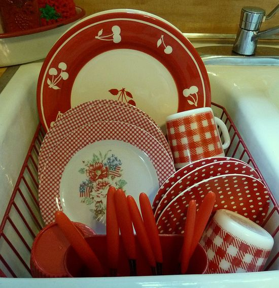 sink full of red dishes!