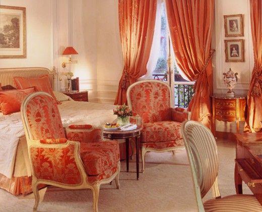 Orange looks beautiful in this bedroom.
