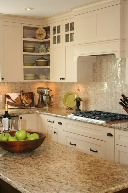 Giallo ornamental granite with glass tile backsplash. Fave so far!